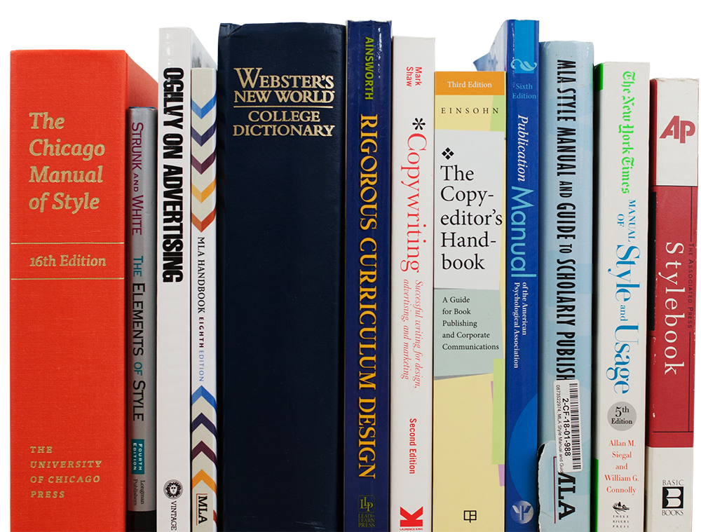 photo of a collection of style guides and books on advertising, marketing, and education