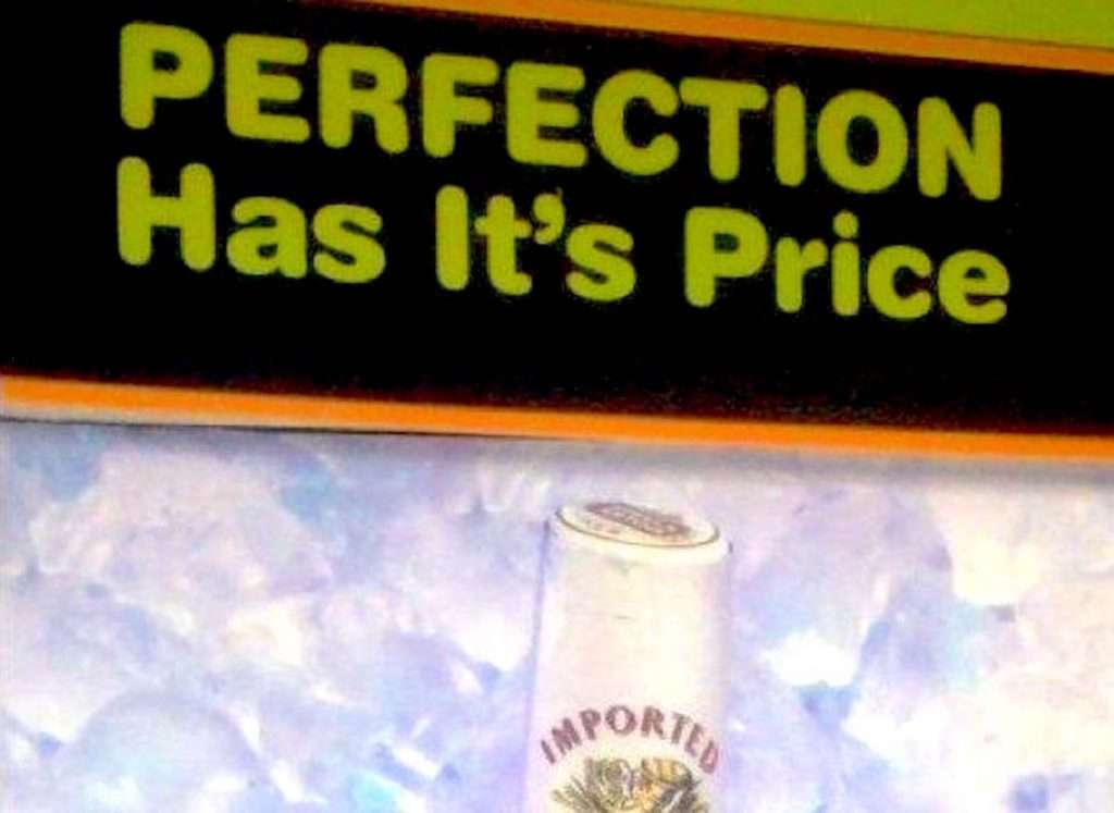 """Image showing a portion of the Stella Artois ad; you can see a little bit of the top of a bottle of beer, and above it is a headline that says, """"PERFECTION Has It's Price,"""" with an apostrophe in the word """"It's."""""""