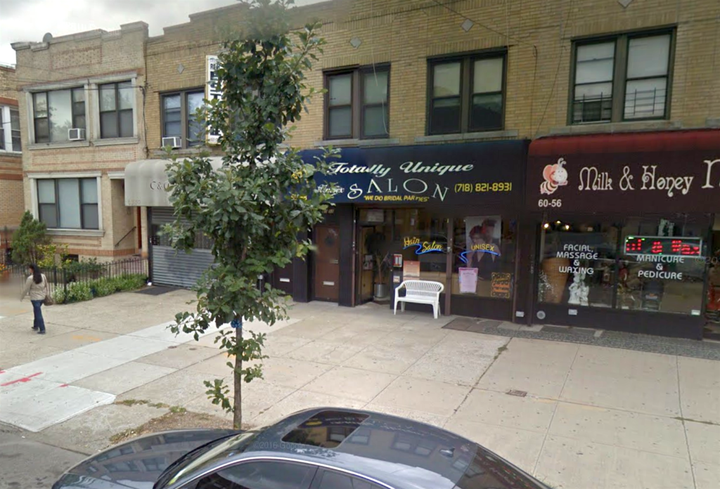 """Photo of some business exteriors on an NYC street; one awning says """"Totally Unique Salon."""""""